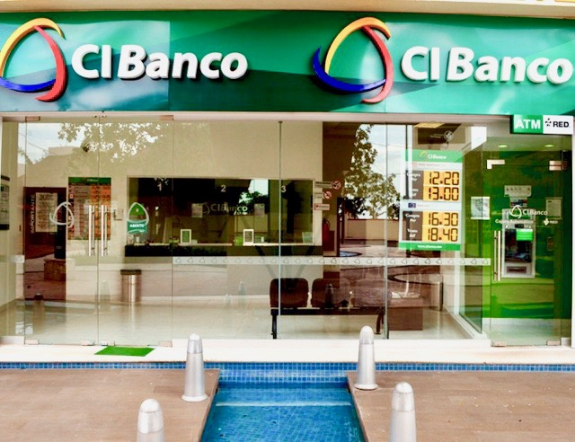 cancun mexico colorful sign hotel zone beach white sand blue clear waters paradise tropical palm trees cibanco bank