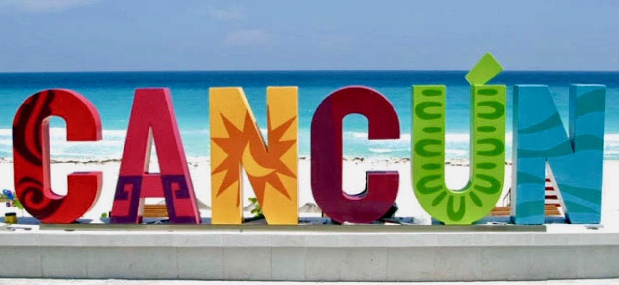 cancun mexico colorful sign hotel zone beach white sand blue clear waters
