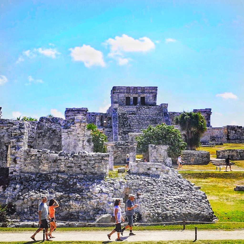 cancun mexico colorful sign hotel zone beach white sand blue clear waters paradise tropical palm trees chicken itza seven wonders world mayan ruins archeological site tulum